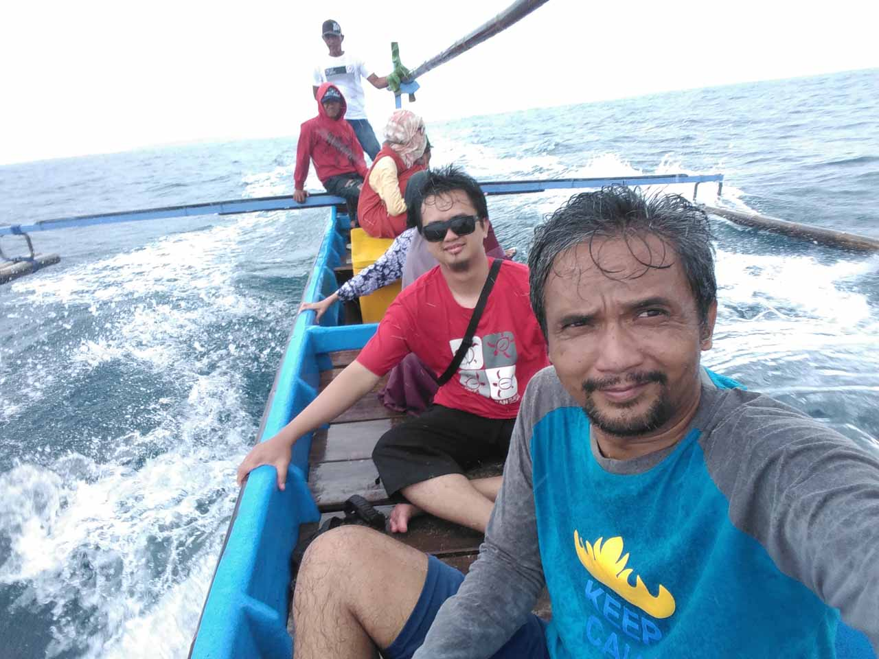 Di atas perahu pulau pisang - kuala stabas - yopie pangkey